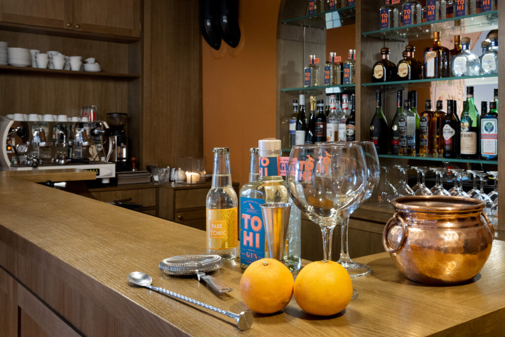 TOHI Cloudberry Mist Noridc Dry Gin on a distillery bar counter